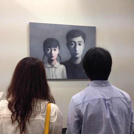 Couple engrossed in Zhang Xiaogang's Bloodline series